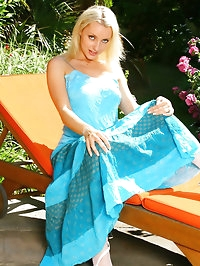 Beautiful Jessie in a long blue summer dress and sexy..